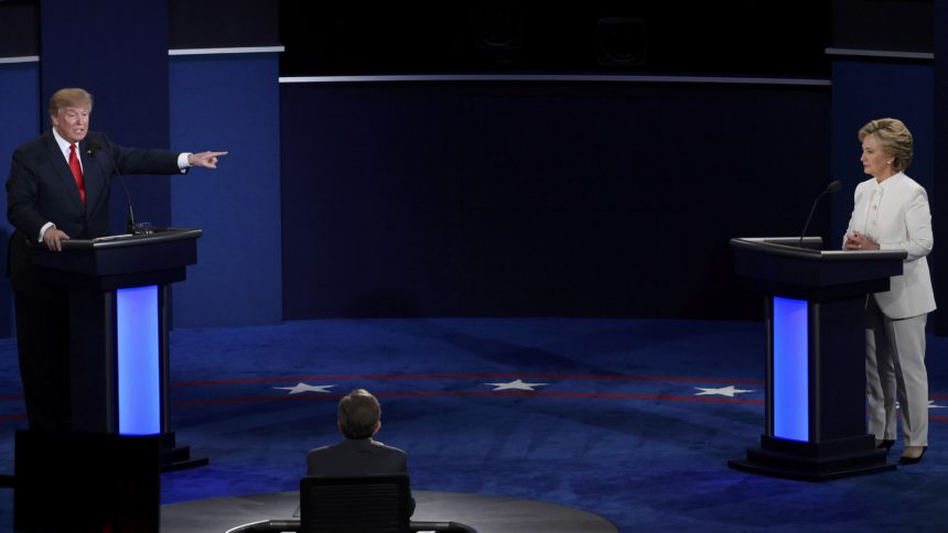 Republican U.S. presidential nominee Donald Trump speaks as Democratic U.S. presidential nominee Hillary Clinton listens during their third and final 2016 presidential campaign debate at UNLV in Las Vegas, Nevada, U.S., October 19, 2016.     REUTERS/David Becker